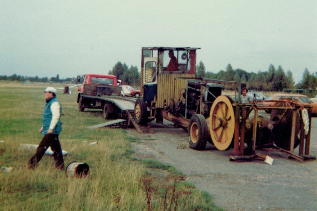 Loading the old winch onto a truck ready for transporting to Burn. Colin Wheat is in the foreground.