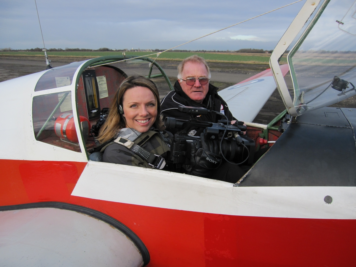 Nicola with video camera being taken for a flight in the Falke by Tony Flannery for some air-to-air shots.