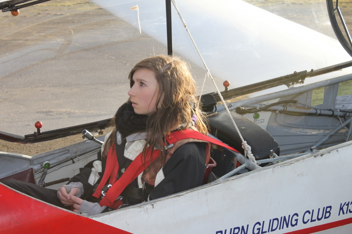 Charlotte Kitchen before her first solo flight just after her 16th birthday.  What is she thinking about?  When asked she said,