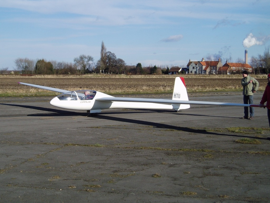 Open Cirrus HTU ready to launch on runway 33 by Alastair Mackenzie.