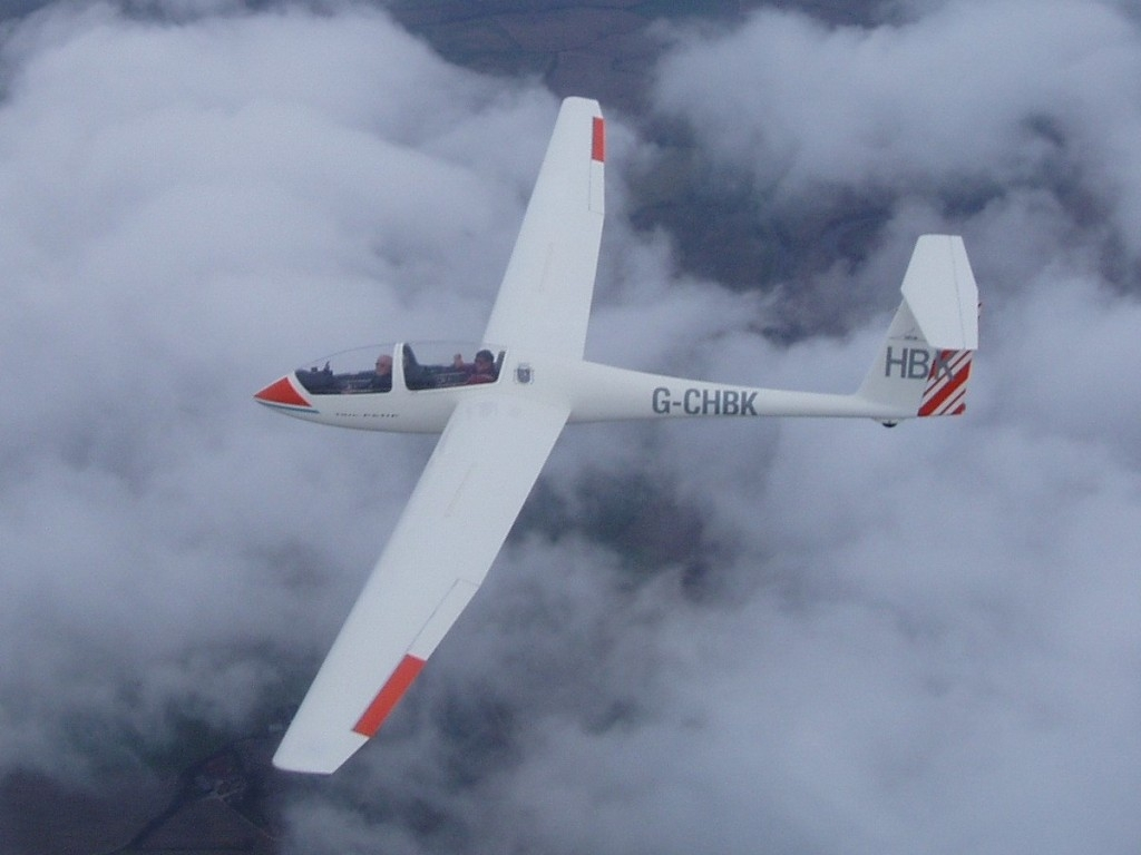 Twin Astir HBK above cloud at 7000ft in wave close to Burn. Picture by Alastair Mackenzie