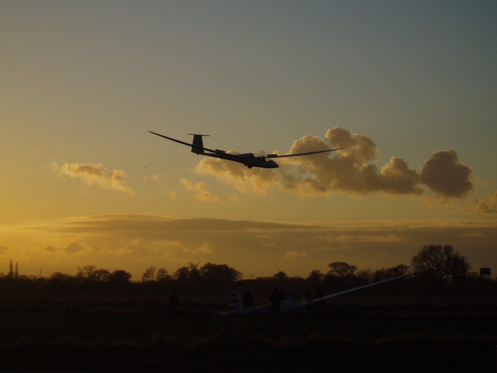 Nimbus 3DT A26 landing at sunset on runway 01 by Alastair Mackenzie.